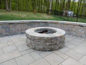 Custom Paver Patio Home Makeover Project showing fire pit and seating wall