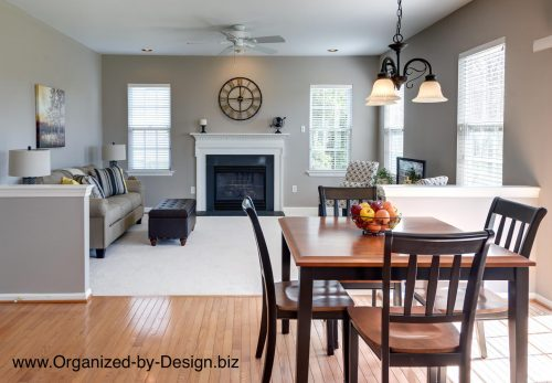 Kitchen eating area and family room staged with furniture and accessories by Organized by Design