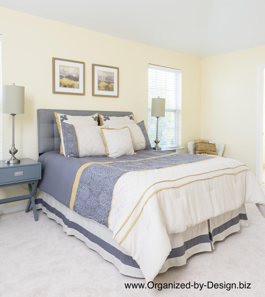 Staged master bedroom organized by design Master bedroom home staging