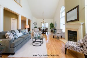 Living Room and Dining Room staged with furniture and accessories by Organized by Design
