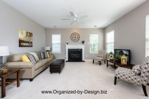 Family Room staged with furniture and accessories by Organized by Design