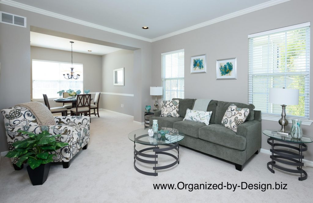Living Room Dining Room Staged with Furniture and Accessories by Organized by Design