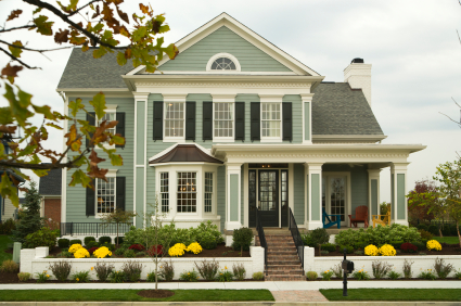 Traditional Home Exterior And Landscaping In Suburban Setting.